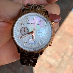 Michael Kors rose gold watch with mother of pearl